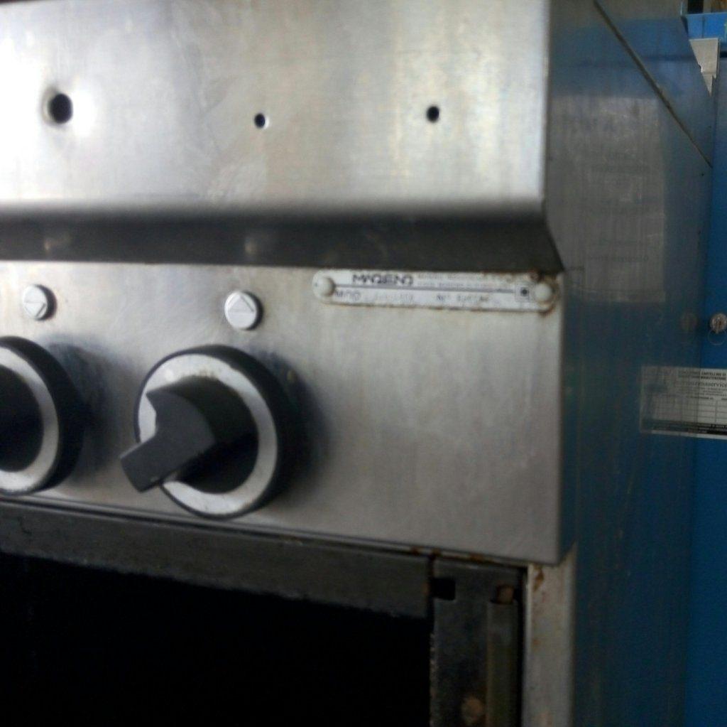 Cucina industriale usata (4 fuochi) in acciaio inox Pomili ...